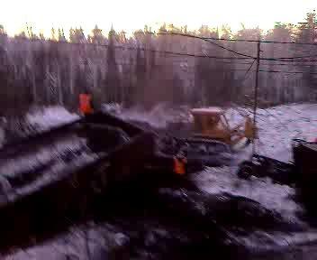 работа трактора с восстановительного поезда