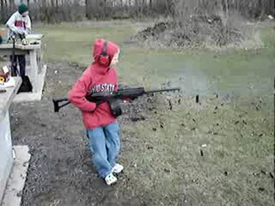 Kid can barely hold still firing a semiautomatic rifle