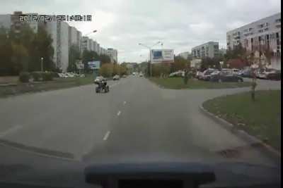 Клоун на квадроцикле