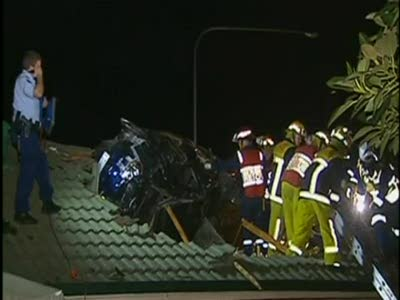 Car embedded in roof in Sydney