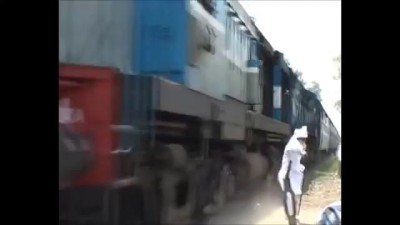 Daring Old Man Facing Fast Train