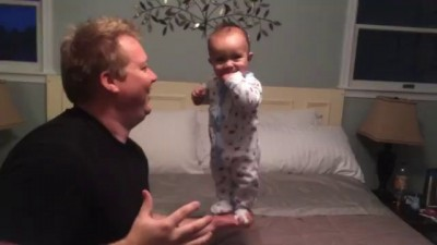 Balancing Baby Laughing with dad