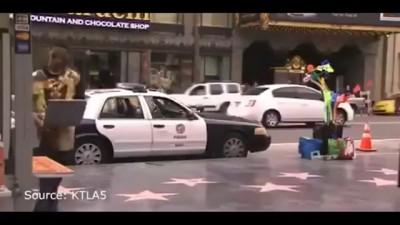 Crazy Guy Does Smash Grab On a Cop Car