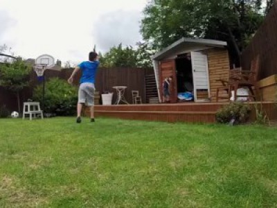 Kid Gets Hit with Soccer Ball and Falls into Shed