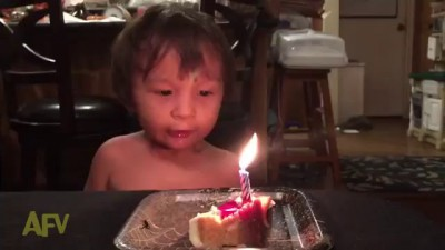 Boy Pulls Out All the Stops to Blow Out Candle