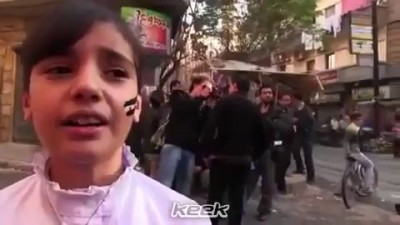 Bomb falls next to a Syrian child while chanting +18 النظا