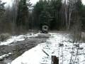 Лесовоз Урал проходит брод
