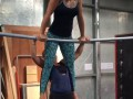 Girls Perform Tandem Spin on High Bar
