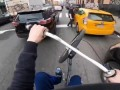 Cyclist Skillfully Weaves His Way through Traffic